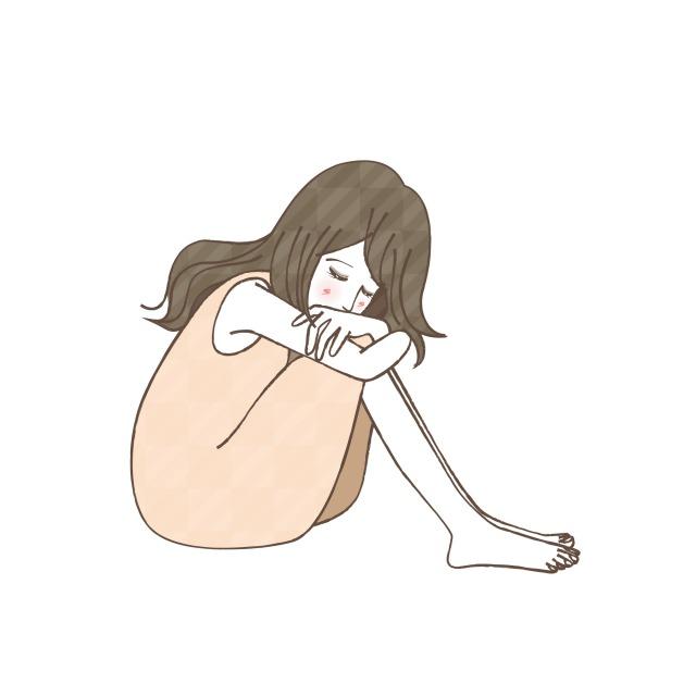 膝を抱えてふさぎ込む女性